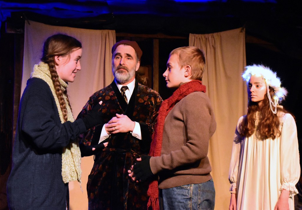 Evelyn Izdepski as Fan tells Shawn Hubbard as Young Ebenezer that he can come home, as David Whitehead (Scooge) and Talia Cutler (Ghost of Christmas Past) look on. Photo by Chip Gertzog.